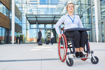 Businesswoman as a wheelchair user in front of the office