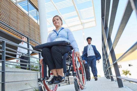 Disabled woman in a wheelchair on a ramp