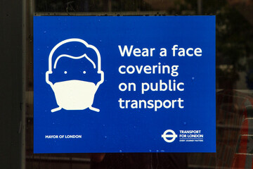 Wear a Face Covering Sign on a London Bus