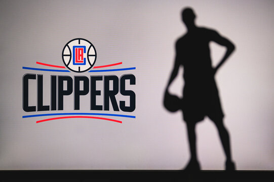 NEW YORK, USA, JUN 18, 2020: Los Angeles Clippers logo of professional basketball club in american league. Silhouette of basket player in foreground. Sport concept photo, edit space.