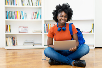 Video call of african american female student at computer