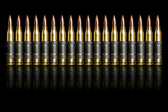 Bullet 5.56 mm chain ammunition isolated on black background