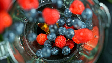 Berries fresh smoothie blended in blender, top view. Healthy eating concept.