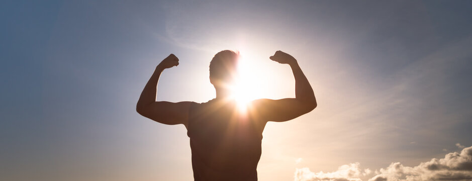 Strong man flexing silhouette. People health and fitness