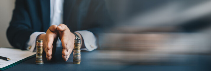 Businessman separates stack coins. Property division. Divorce and legal services. Concept of ...