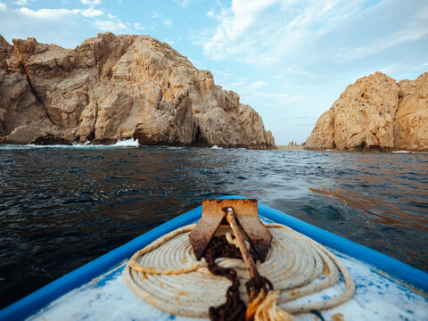 Old rustic front of boat pulling up to beach shoreline in Los Cabos