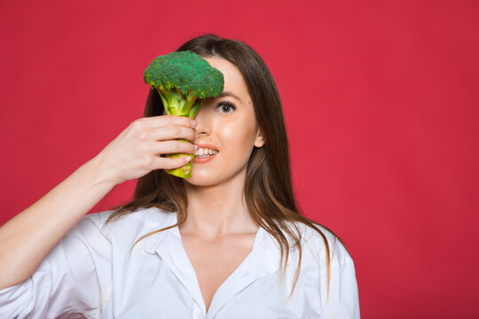 Girl hold vegetable. Organic nutrition. Woman hold broccoli. Healthy vegetarian recipes. Amazing broccoli facts you should know. Healthy food. Dieting concept. Eat healthy.