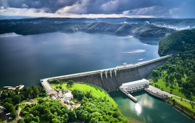 The Solina Dam aerial view, largest dam in Poland located on lake Solinskie. Hydroelectric power plant in Solina of Lesko County in the Bieszczady Mountains area of south-eastern Poland. Fotomurales