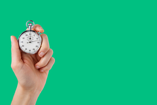 stopwatch hold in hand, button pressed, green background