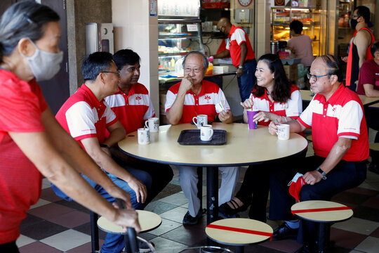 Tan Cheng Bock of the Progress Singapore Party has breakfast with party members at a food center in Singapore