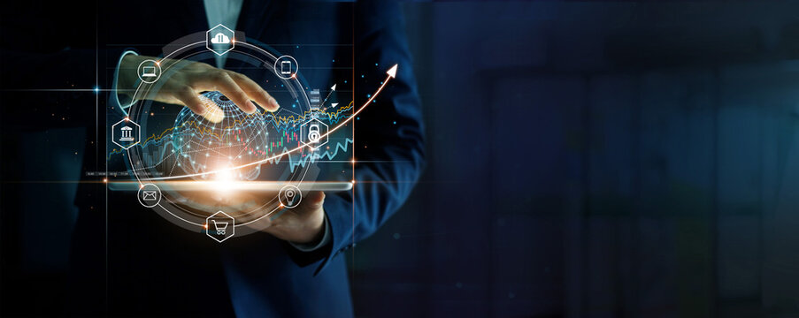 Businessman touching business global network on tablet and business economic growth graph chart, Strategy and planning on success of investment.