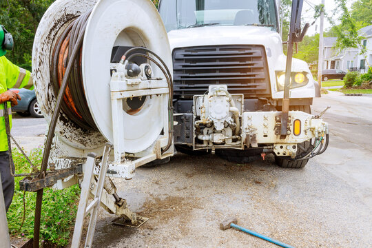Machine for cleaning blocked drains and sewers with selective focus on town street.
