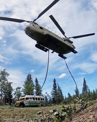 """laska Army National Guard CH-47 Chinook helicopter carries the bus made famous by the """"Into the Wild"""" book and movie near Stampede Trail"""
