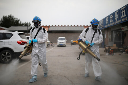 Volunteers from the Blue Sky Rescue team disinfect the Nangong comprehensive market in Beijing