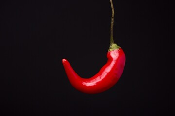 Canvas Prints Hot chili peppers Closeup shot of a fresh red hot chili pepper isolated on the black background