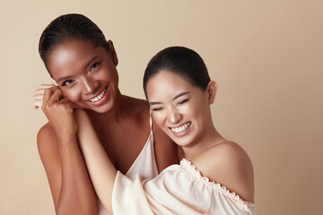 Diversity. Beauty Models Portrait. Cheerful Asian And Mixed Race Women Bonding Hands And Laughing....