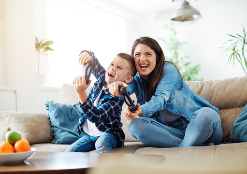 child son mother family happy playing console kid childhood joystick cotroller