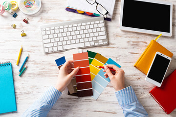 Interior designer choosing colors from swatches