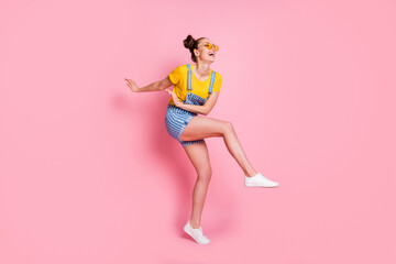 Full length body size view of her she nice attractive carefree slim fit thin cheerful cheery glad brown-haired girl jumping dancing having fun chill out party isolated on pink pastel color background