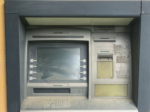 Old, non-working ATM. ATM in the dust. No money.