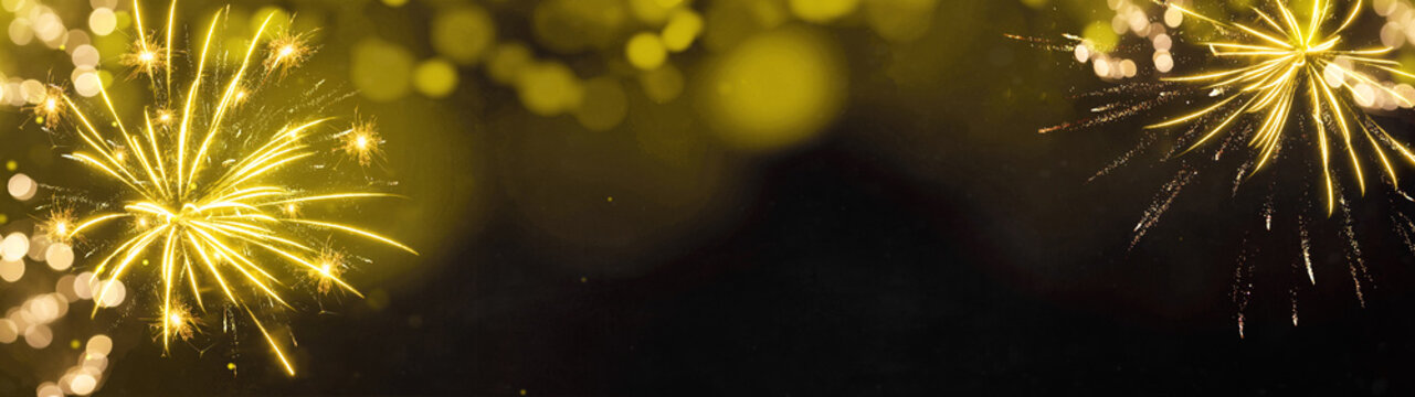 Abstract festive Silvester Party celebration background panorama banner long - Golden yellow firework with red bokeh lights on black night texture, with copy space