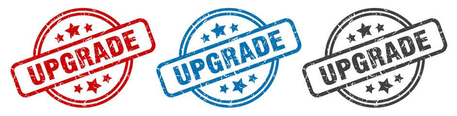 upgrade stamp. upgrade round isolated sign. upgrade label set