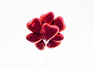 Red heart-shaped balloons isolated on white background, concept of love in summer and valentine, wedding