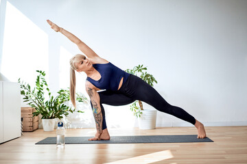 Fit woman exercise yoga at home