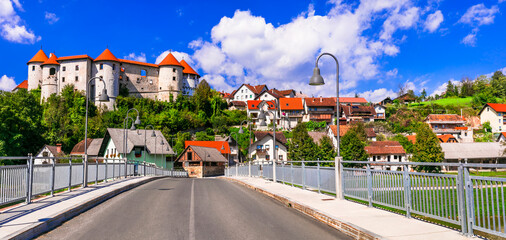 Slovenia landmarks and travel - medieval castle and village Zuzemberk over Krka river