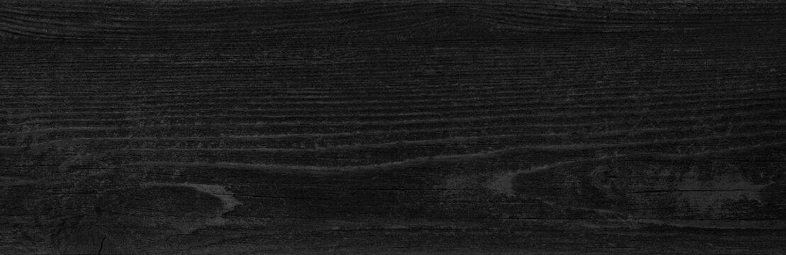 Black wood background. Dark painted wooden board texture