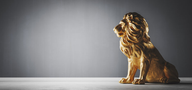 Golden statue of lion, a sculpture. Concept of a strength, power