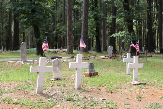 Cemetery with white crosses and American flags