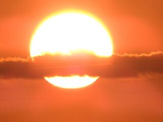 Photo sur Toile Corail soleil avec nuage
