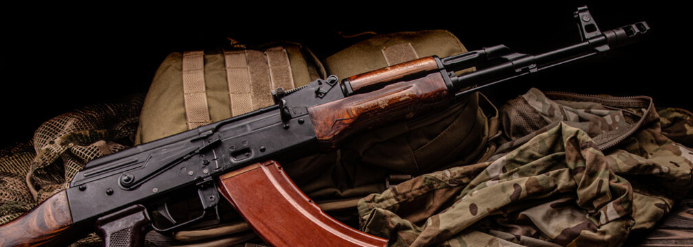 Classic Soviet AK machine gun on a wooden back. Weapons of Russia and the Soviet Union.