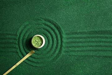 Green matcha powder background. Zen background. Top view.