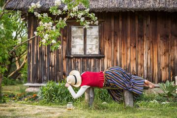 Glass of beer and woman sleeping on a bench, Ligo