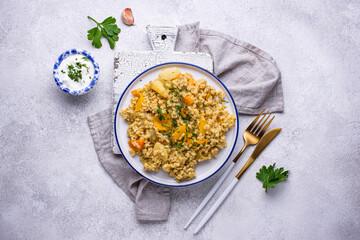 Stewed healthy bulgur with vegetables