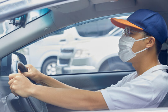 asian drivers put on masks to protect against viruses, dust
