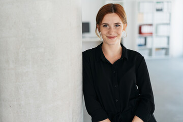 Friendly young businesswoman smiling at camera
