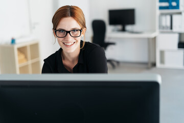 Attractive businesswoman working at a computer
