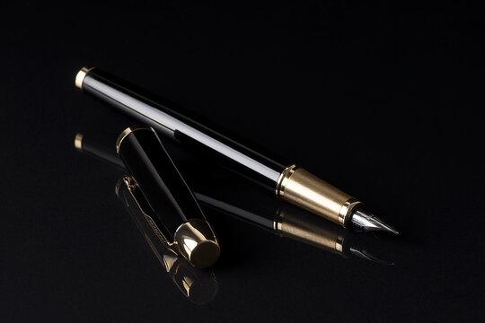 fountain pen on black