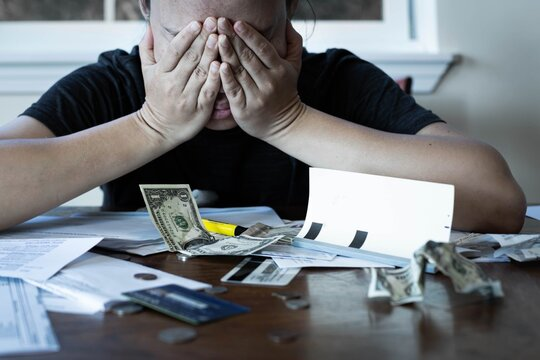 Stressed woman worrying about financial debt and monthly bills. Money crisis.