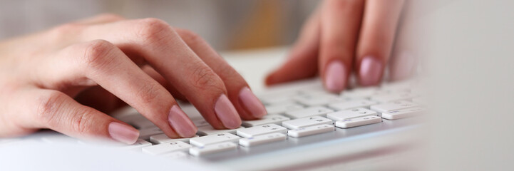 Autocollant pour porte Fleur Female hands typing on silver keyboard using computer pc at workplace closeup. White collar job, digital shopping, office lifestyle, search success, enter login, password and credentials concept