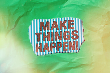 Conceptual hand writing showing Make Things Happen. Concept meaning inspiration and motivation more efforts to achieve success Green crumpled colored paper sheet torn colorful background