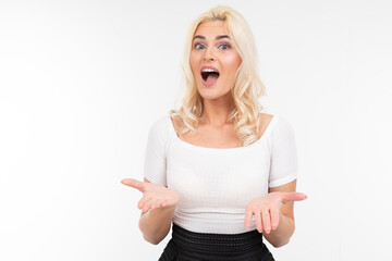 surprised blonde girl in a white t-shirt on a white background with copy space