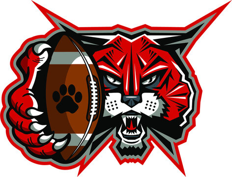 wildcat football mascot holding ball in claw for school, college or league