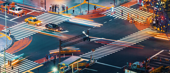 People and traffic cross the famous scramble intersection in Shibuya, Tokyo, Japan, one of the...