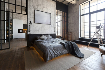 Fototapeta luxury studio apartment with a free layout in a loft style in dark colors. Stylish modern kitchen area with an island, cozy bedroom area with fireplace and personal gym obraz