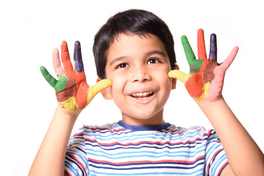 Young Indian Boy showing his painted hands
