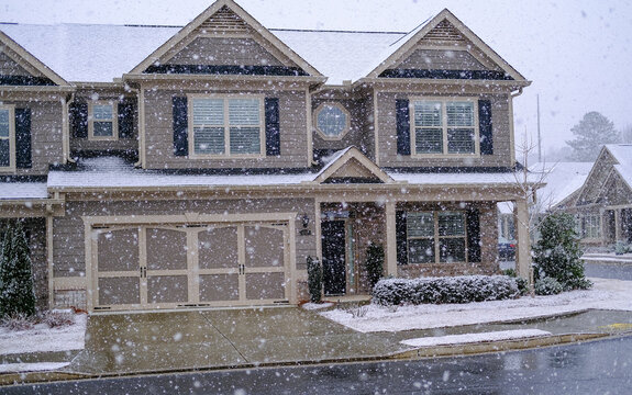 Snow Falling on Townhouses.